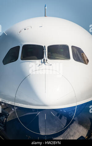 nose cone closeup of a larger passenger jet airliner - Stock Photo