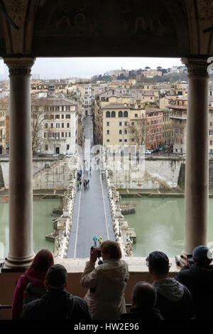 ROME, ITALY -  MARCH 5, 2017: Tourist group at Sant Angelo Castle take photos of Sant Angelo Bridge on a rainy day - Stock Photo