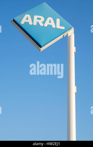 Aral sign against blue sky. Aral is a brand of automobile fuels and petrol stations, present in Germany and Luxembourg. - Stock Photo