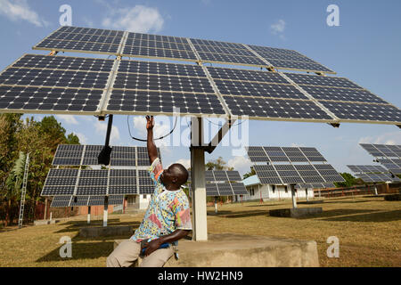 UGANDA, Arua, solar power, swingable solar panels for power supply of Radio station Radio Pacis / autarke Stromversorgung - Stock Photo