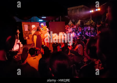 Crowd watching the Papermoon Puppet Theatre show entitled 'SirdusKarkus' in the plaza in Jakarta old town, Indonesia. - Stock Photo