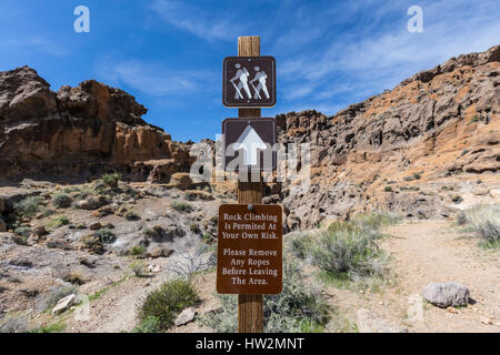 Trail and rock climbing sign at the Mojave National Preserve in Southern California. - Stock Photo
