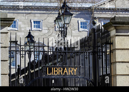 wrought iron gates and old gas lights at the entrance to the national library Dublin Republic of Ireland - Stock Photo