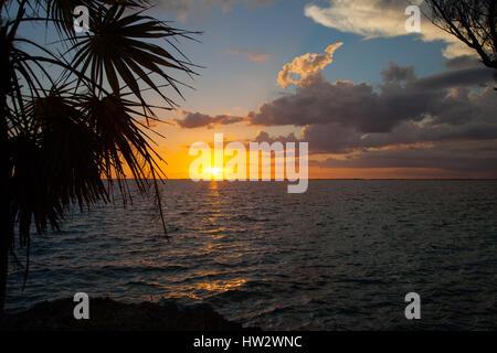 Beautiful sunset over the ocean bay at Playa Giron, Cuba - Stock Photo