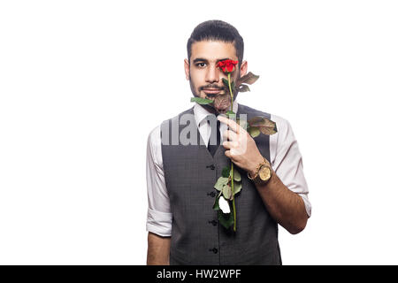 Handsome romantic happy man with rose flower. studio shot. isolated on white background. holding flower in front - Stock Photo