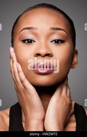 beautiful face of black asian blasian woman with cosmetics