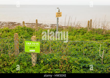 HUNSTANTON, ENGLAND - MARCH 10: The Samaritans sign 'talk to us, if things are getting to you' next to Hunstanton - Stock Photo