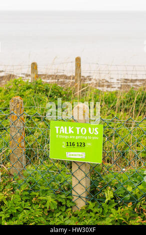 HUNSTANTON, ENGLAND - MARCH 10: The Samaritans sign 'talk to us, if things are getting to you' at Hunstanton cliffs - Stock Photo