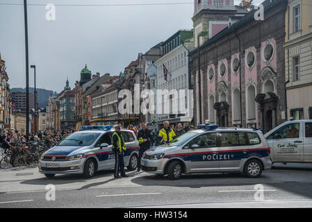 Police road block one of the main streets in the centre of Innsbruck as part of crowd control for a protest march - Stock Photo