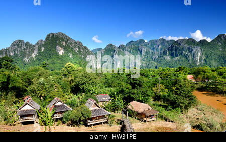 The village in vangvieng at the country side of Lao  in clear sun lighting with blue sky.