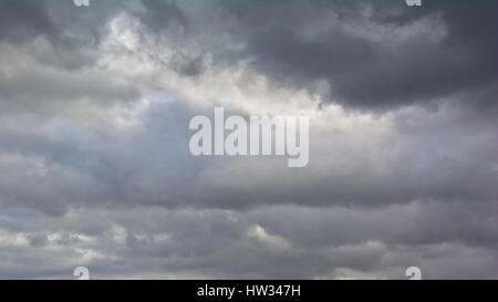 Dramatic dark stormy sky, stratocumulus clouds background - Stock Photo