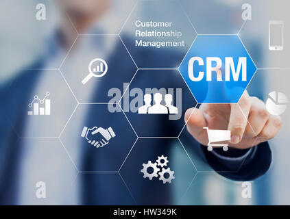 Customer relationship management concept with businessman touching button in background, communication, marketing - Stock Photo