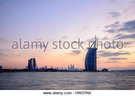 The iconic Burj Al Arab, Jumeirah Beach Hotel  Hotel and the 360 lounge (on the left), Dubai, United Arab Emirates - Stock Photo