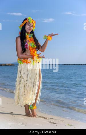 Hula Hawaii dancer dancing on the beach with horizon of sea. Ethnic woman in costume dancer Hawaii hula dancing - Stock Photo