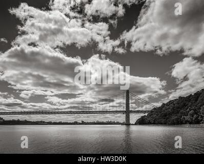 George Washington Bridge spanning Hudson River with clouds in Black & White. New York City