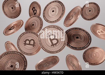 Close up of copper bitcoins tossed into the air as example for blockchain and crypto-currency concept - Stock Photo