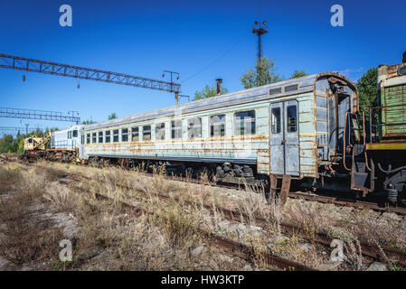 Old train in abandoned Yaniv town railway station, Chernobyl Nuclear Power Plant Zone of Alienation around the nuclear - Stock Photo