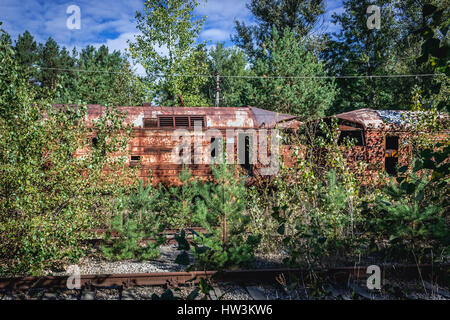 Rusty wagons in abandoned Yaniv town railway station, Chernobyl Nuclear Power Plant Zone of Alienation around the - Stock Photo