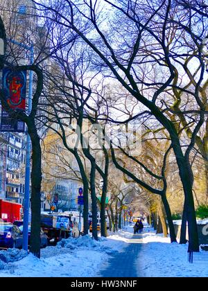 People walking on Museum Mile path cleared of snow after Blizzard Stella, New York City, USA. - Stock Photo