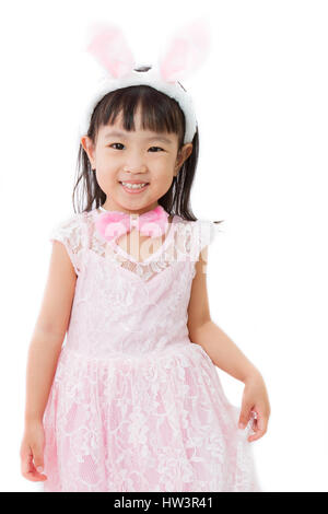 Chinese Little Girl in banny costume on plain white isolated background. - Stock Photo