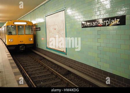 Berlin subway (U-Bahn):Yellow wagon at Alexanderplatz station - Stock Photo