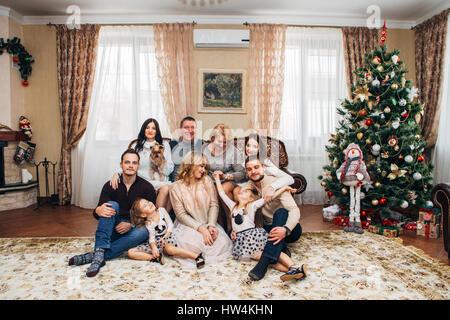 big happy family near Christmas tree - Stock Photo