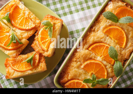 Traditional Greek Orange Pie With Phyllo - Portokalopita close-up on a table. horizontal view from above - Stock Photo