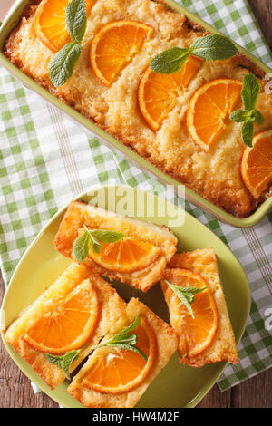 Traditional Greek Orange Pie With Phyllo - Portokalopita close-up on a table. Vertical view from above - Stock Photo