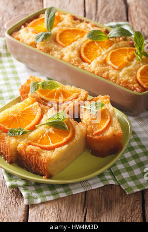 Traditional Greek Orange Pie With Phyllo - Portokalopita close-up on a table. Vertical - Stock Photo