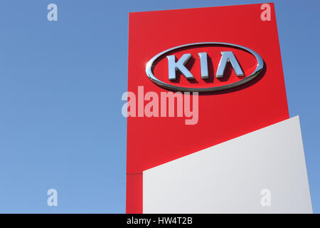 Kia dealership sign against blue sky - Stock Photo
