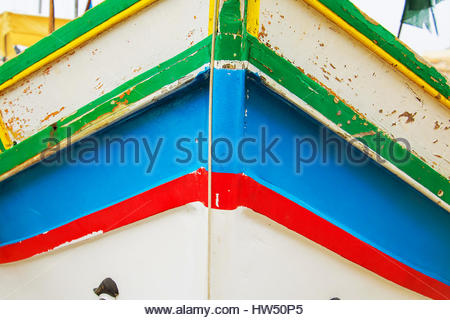 Detail view of a traditional Maltese colourful painted fishing boat, Luzzu, famous Malta boats Eye of Orisis, mediterranean - Stock Photo