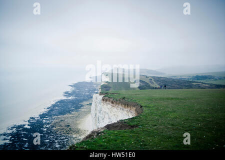 Each year thousands of tourists visit the chalk cliffs the Beachy Head and the Seven Sisters in Southern England - Stock Photo