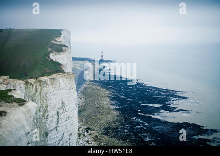 Right bellow the Beachy Head cliff you find the Beachy Head Lighthouse that was built in the sea to avoid ship collisions - Stock Photo