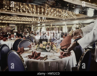 Cruise ship dining room prepared for evening meal. - Stock Photo