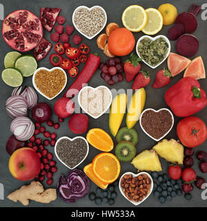 Palaeolithic diet food of fresh fruit, vegetables, nuts and seeds on slate background. High in antioxidants, vitamins, - Stock Photo