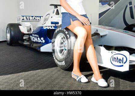Grid girl legs seated on Sauber BMW Formula 1 car wheel - Stock Photo