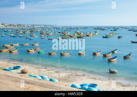 A lot of fishing boats near fisherman village in rural area of Mui Ne, Southern Vietnam. - Stock Photo