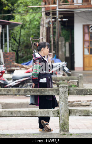 Sapa, Lao Cai, Vietnam - 6 May 2014: Tribal Hmong woman in national clothes on the street of Sapa, Northern Vietnam. - Stock Photo