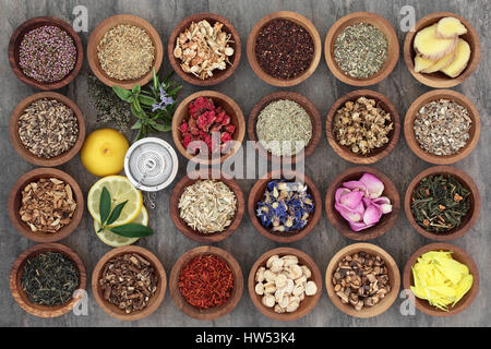 Healthy herb tea selection in wooden bowls and loose with strainer, teas also used in alternative medicine. - Stock Photo