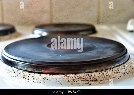 Old and worn electric cooker hob - Stock Photo