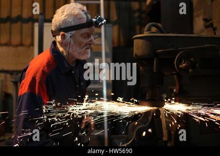 Somerset, Uk. Mechanical engineer David Andrews works on job repairing machinery for Somdor Engineering - Stock Photo