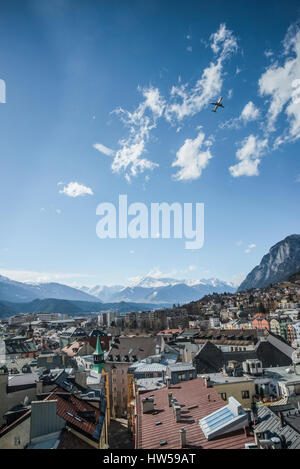 City landscape and aerial view over the roof tops of Innsbruck, provincial capital of the Tirol in Austria - Stock Photo
