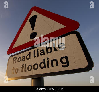 Warning sign ,road liable to flooding on rural road in Peak District National Park,Derbyshire,United Kingdom. - Stock Photo