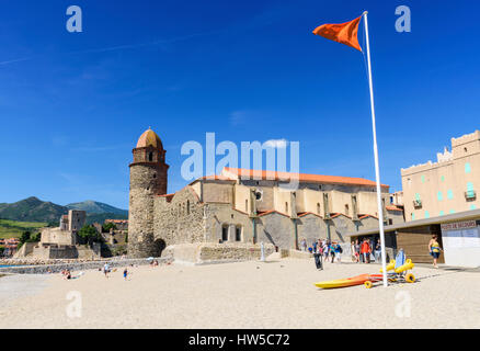 Orange warning flag on St Vincent Beach - bathing dangerous but watched - overlooked by the Notre Dame des Anges, - Stock Photo