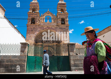 Potosi, Bolivia - November 29, 2013: People in front of a church in the city of Potosi in Bolivia. - Stock Photo