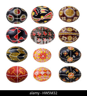 There are pysankas with traditional Ukrainian ornaments and symbols. The Easter eggs are decorated with a pattern - Stock Photo