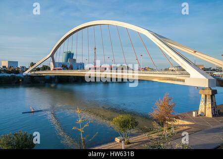 Spain, Andalusia, Seville, Guadalquivir basin and Barqueta Bridge built by Juan Jose Arenas and Marcos J. Pantaleon - Stock Photo