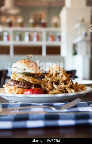 burger with onion rings and fries - Stock Photo