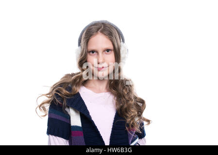 Pretty smiling little girl with curly hairstyle wearing colorful sweater and headdress isolated on white background. - Stock Photo
