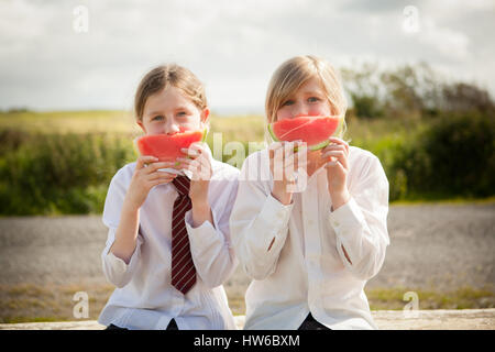 Girls eating watermelon - Stock Photo